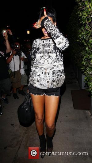 Rihanna Hits Back At Chris Brown With Gold Teeth Grill