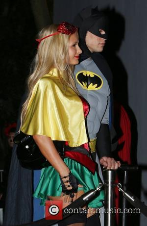 Paris Hilton and boyfriend River Viiperi, dressed as Batman and Robin,  arrive at Rihanna's Halloween party held at Greystones...
