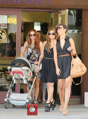 Vanessa White, Frankie Sandford and Una Healy,  of The Saturdays shopping on Robertson Boulevard. They were filming for their...