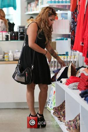 Vanessa White,  of The Saturdays shopping on Robertson Boulevard. They were filming for their reality show to be shown...