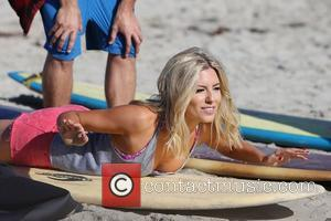 Mollie King of The Saturdays takes surfing lessons on Venice Beach Los Angeles, California - 10.10.12