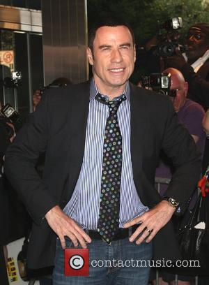 Travolta Still Attracts The Girls