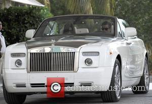 Scott Disick and Khloe Kardashian take a ride in a Rolls Royce Phantom through Miami Beach Miami, Florida - 18.09.12