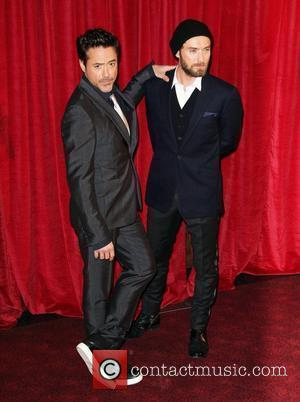Robert Downey Jr. and Jude Law 'Sherlock Holmes: A Game of Shadows' premiere - Arrivals London, England - 08.12.11