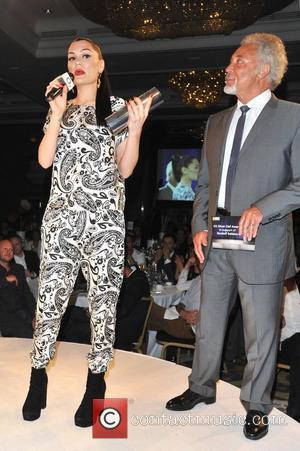 Jessie J and Tom Jones The Nordoff Robbins O2 Silver Clef Awards held at the Hilton Park Lane. London, England...