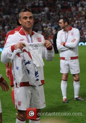 Robbie Williams Returning To Native U.k. For Baby's Birth