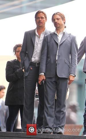 Brad Pitt and his stunt double filming a scene of his new movie 'The Counselor' on location in London The...