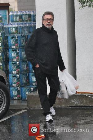 Tim Curry out shopping at Bristol Farm Foods wearing an oversized black jumper and white trainers Los Angeles, California -...