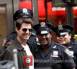 Tom Cruise filming on the set of 'Oblivion' at the foot of the Empire State Building New York, City, USA...