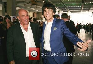 Sir Phillip Green and Ronnie Wood High street retailers catwalk show to celebrate the British Fashion Council's inaugural menswear showcase...