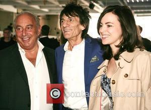 Sir Phillip Green and Ronnie Wood with Sally Humphreys High street retailers catwalk show to celebrate the British Fashion Council's...