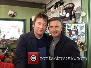 Gary Barlow posted this image of himself with Jamie Oliver on Twitter with the caption: Been in Jamie's kitchen this...