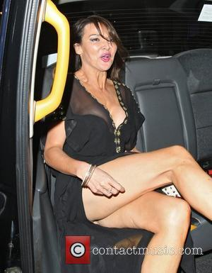 Lizzie Cundy appears not be wearing any underwear as she gets into a taxi shortly after leaving the UK Lingerie...