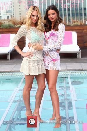 Candice Swanepoel and Miranda Kerr Victoria's Secret 'SWIM' collection 2012 - Photocall Beverly Hills, California - 29.03.12