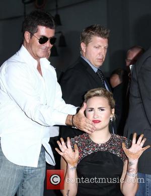 Simon Cowell Praises Demi Lovato's Recovery
