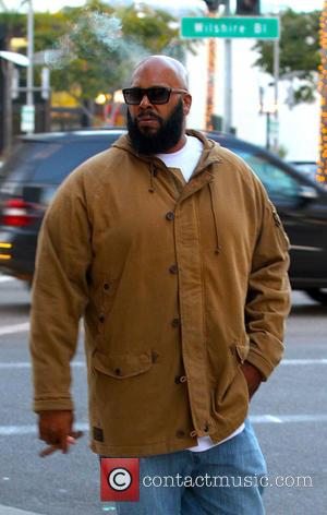 Suge Knight and Suge Knight - Hip-Hop Producer Suge Knight sighted smoking a cigar walking on Wilshire Boulevard - Beverly...