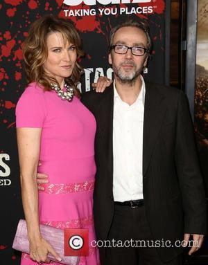 Lucy Lawless and John Hannah -