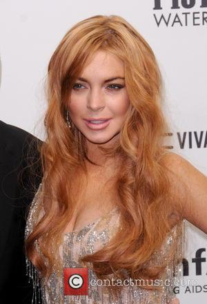 Lindsay Lohan Loses Pitbull Legal Spat