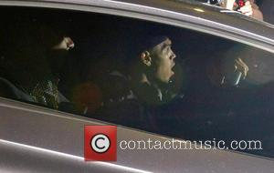 Chris Brown - Chris Brown driving out of Greystone