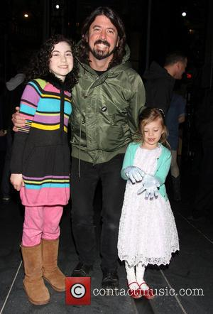 Lilla Crawford, Dave Grohl and Harper Grohl - Dave Grohl takes his daughters to the Broadway musical 'Annie' at the...