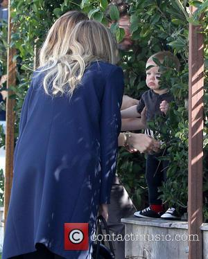 Hilary Duff and Luca Cruz Comrie - Hilary Duff holds her young son up to practice his balance, as she...