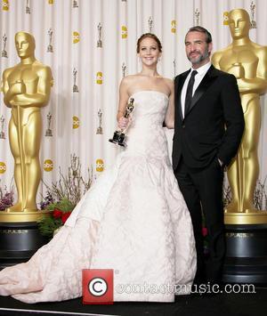 Jennifer Lawrence and Jean Dujardin - Oscars Press Room at Oscars - Los Angeles, California, United States - Sunday 24th...