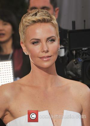 Charlize Theron - The 85th Annual Oscars at Hollywood & Highland Center - Red Carpet Arrivals - Los Angeles, California,...