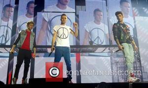 Niall Horan, Zayn Malik, Liam Payne and One Direction - One Direction perform at London's O2 Arena - London, United...