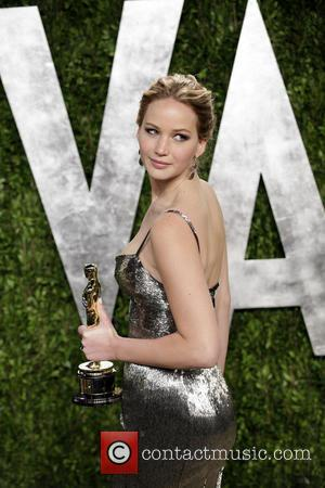 Jennifer Lawrence - 2013 Vanity Fair Oscar Party at Sunset Tower - Arrivals - West Hollywood, California, United States -...