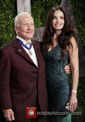 Buzz Aldrin and guest - 2013 Vanity Fair Oscar Party at Sunset Tower - Arrivals - West Hollywood, California, United...