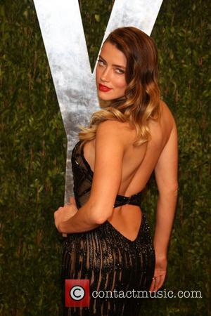 Amber Heard - 2013 Vanity Fair Oscar Party at Sunset Tower - Arrivals - Los Angeles, California, United States -...