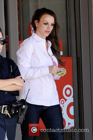 Britney Spears - Britney Spears is escorted by an officer