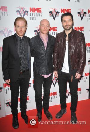 Ben Johnson, Simon Neil, James Johnson of Biffy Clyro - The 2013 NME Awards held at The Troxy - Arrivals...