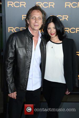 William Fichtner and Kimberly Kalil - Los Angeles premiere of 'Phantom' at the Chinese Theatre - Arrivals - Los Angeles,...