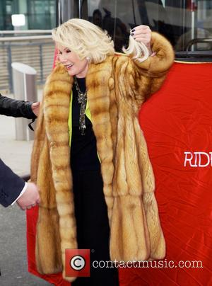 Joan Rivers - Joan Rivers gets a hair trim by her daughter Melissa as Gray Line New York inducts the...