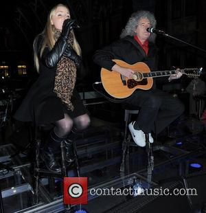 Kerry Ellis and Brian May - Artists perform at St. Pancras Station to raise awareness for the 'Born Free Foundation'...
