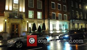 Justin Bieber's limousine parked with it's headlamps on outside the London Clinic Hospital in Marylebone where he was admitted after...