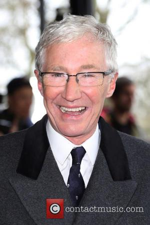 Paul O'Grady - The Tric Awards 2014 held at the Grosvenor House Hotel - Arrivals - London, United Kingdom -...
