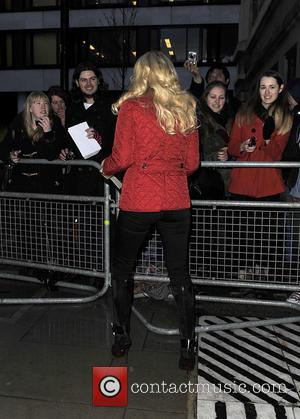 Carrie Underwood - Carrie Underwood signs autographs for fans at the BBC Radio 2 studios - London, United Kingdom -...