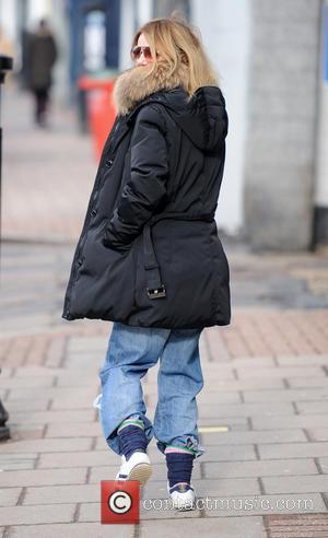 Geri Halliwell - Geri Halliwell walks her daughter Bluebell to school - London, United Kingdom - Monday 18th March 2013