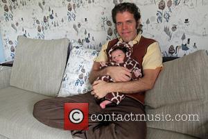Perez Hilton Mario Armando Lavandeira III - Perez Hilton poses with his newborn son Mario Armando Lavandeira III at his...