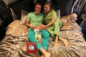 Perez Hilton Mario Armando Lavandeira III and Teresita Lavandeira - Perez Hilton poses with his newborn son Mario Armando Lavandeira...