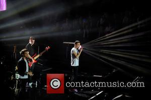One Direction, Liam Payne and Louis Tomlinson - One Direction performing in concert at the LG Arena - Birmingham, United...