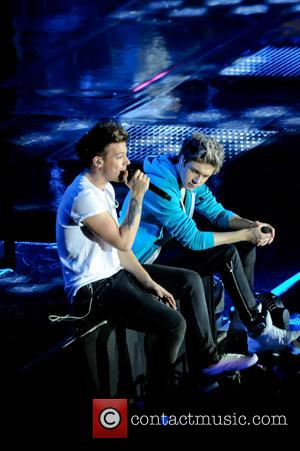 One Direction, Niall Horan and Louis Tomlinson - One Direction performing in concert at the LG Arena - Birmingham, United...