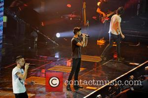 One Direction, Zayn Malik, Liam Payne and Harry Styles - One Direction performing in concert at the LG Arena -...