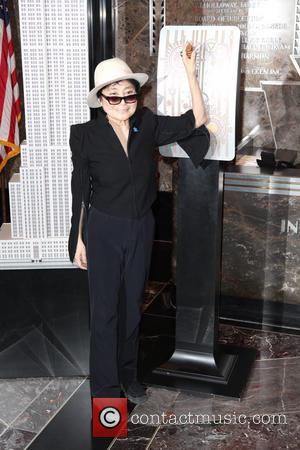 Yoko Ono - Global Autism Ambassador Yoko Ono and Autism Speaks Co-Founders Suzanne and Bob Wright light The Empire State...