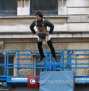 Benedict Cumberbatch - Benedict Cumberbatch films a scene for the third series of 'Sherlock' in central London - London, United...