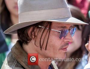 Johnny Depp Relationship Rumors Still On Amber At Rolling Stones Gig