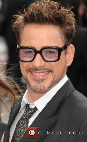 Robert Downey Jr, Rebecca Hall, Stanley Tucci Among Guests At 'Iron Man 3' Premiere [Pictures]