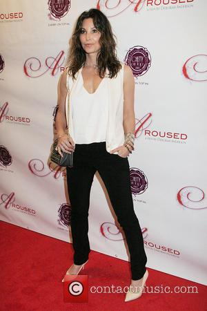 Gina Gershon - Premiere of 'Aroused' held at the Landmark...